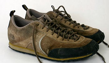 Photograph of well-worn shoes, represents the need for a good college that feels like a cozy fit.
