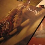 A stack of University of Chicago college pamphlets.