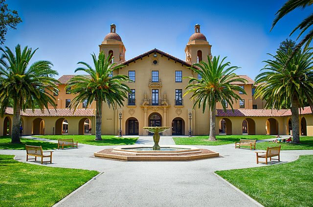 Stanford University building surrounded with palm trees.