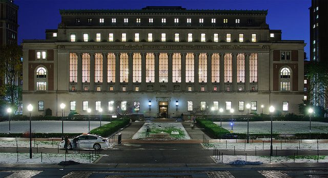 Butler Library at Columbia University lit up at night.