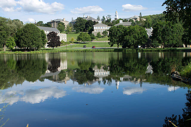 Colgate University buildings with Taylor Lake in the foreground.