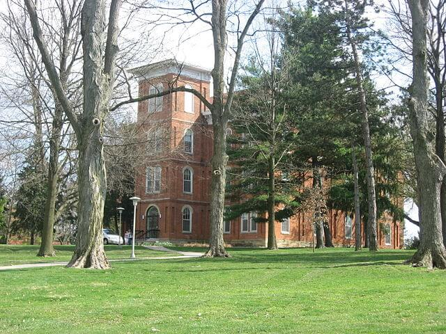 Wilmington College Hall surrounded by trees.