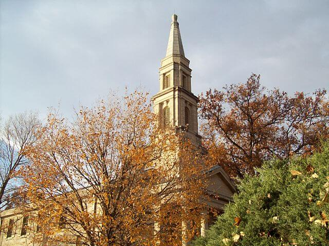 Bell tower at Chapel in the Principia College, surrounded by autumn trees.