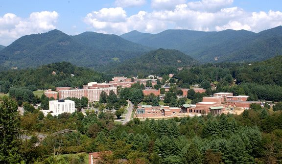 Western Carolina University campus from afar. Surrounded with trees and mountains on the background.