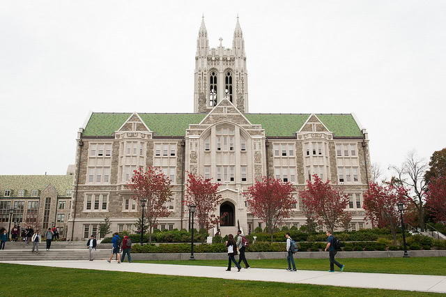 Students walking outside the O'Neill Library at Boston College.