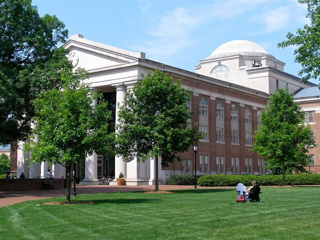 Student sitting on the lawn at Davidson College.