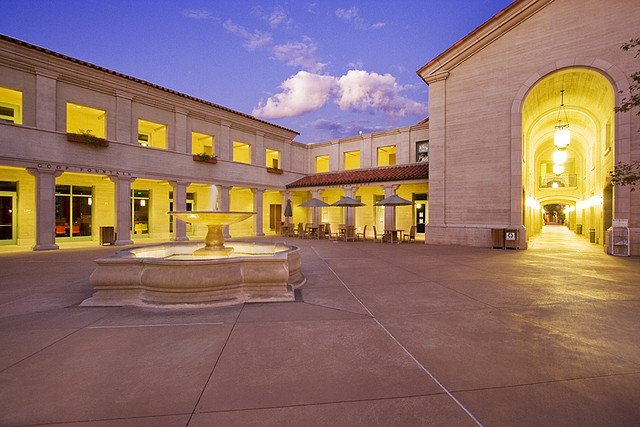 Pomona College Campus Center and water fountain at dusk.