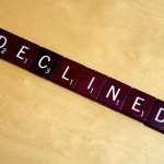 """Scrambled letters arranged as the word """"declined""""."""