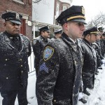 Officers lined up on snowy weather.