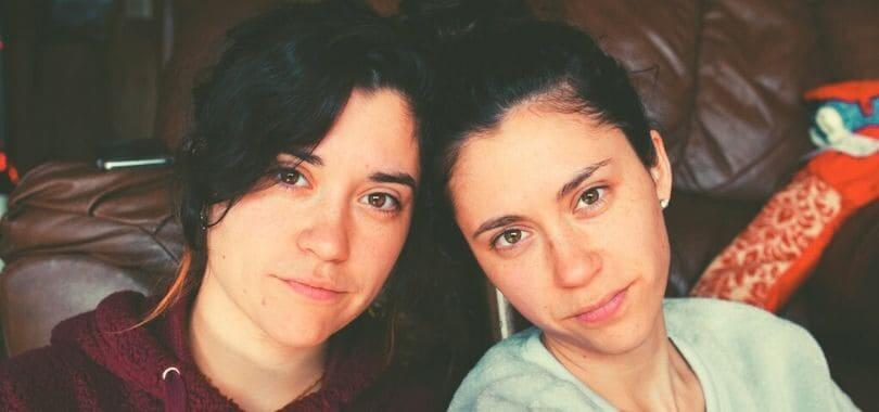 A pair of siblings looking at the camera.