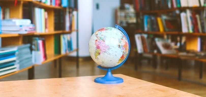 A globe on a desk.