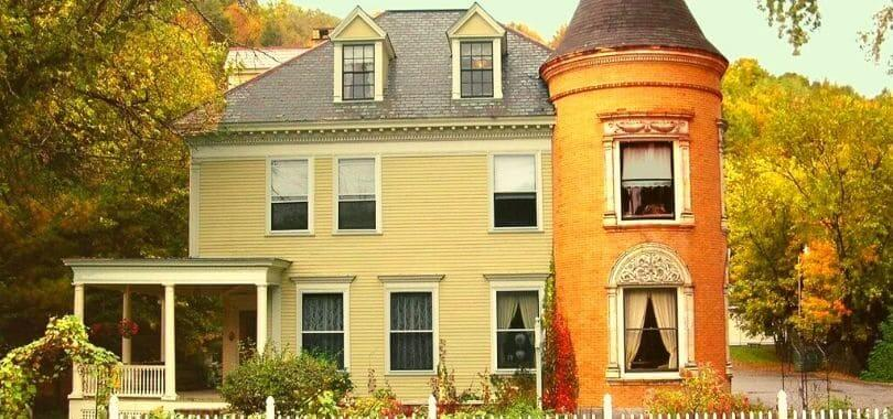 A beige and orange house in New England.
