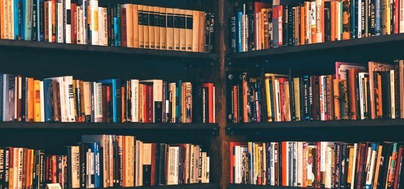 Multiple bookshelves filled with books.