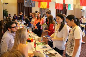 Students inquiring about study abroad opportunities at Roanoke College during the informational fair.
