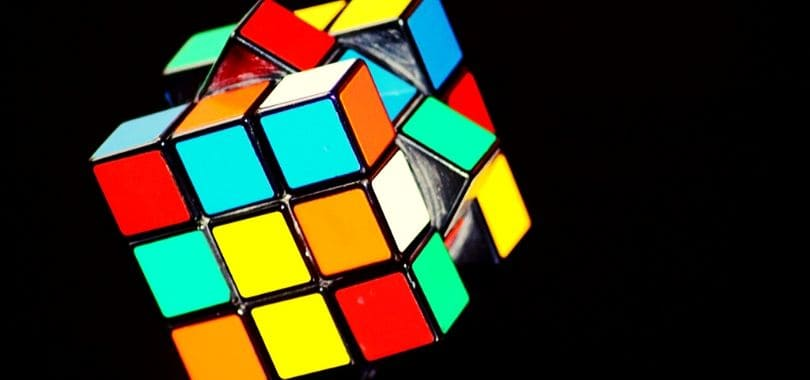 A colorful Rubik's cube on its side.