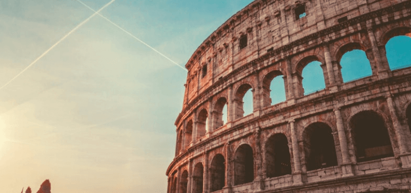 The Colosseum with a sunset in the background.