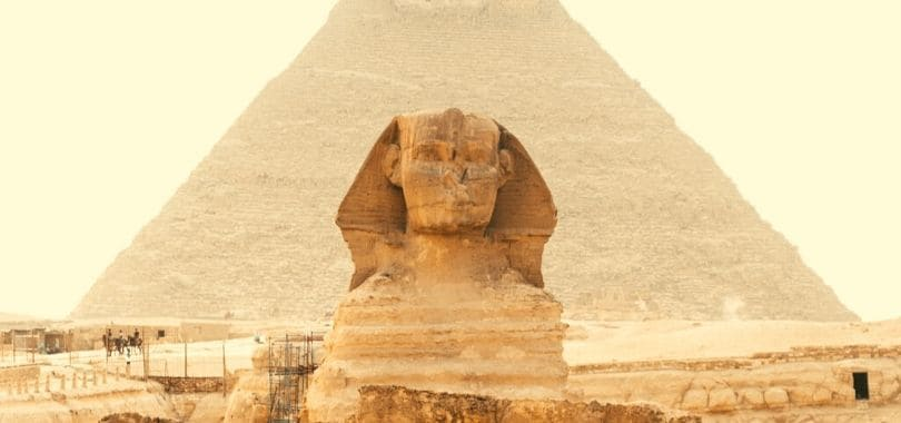 The Sphinx with a pyramid behind it.