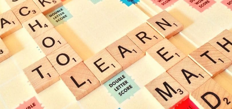 """Scrabble tiles that spell """"school,"""" """"learn,"""" and """"math."""""""