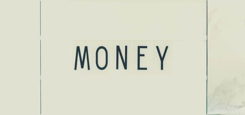 """A white sign that says """"money."""""""