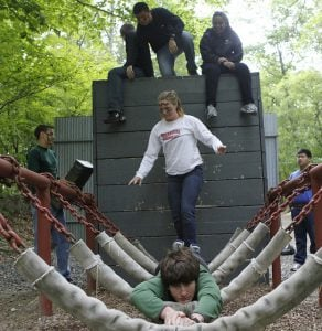 Students on a challenging obstacle course as part of orientation.