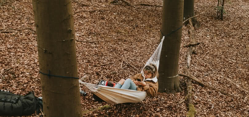 Student leaning in a hammock.