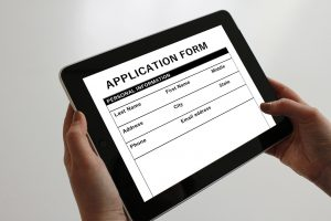 An online college application form in an iPad.