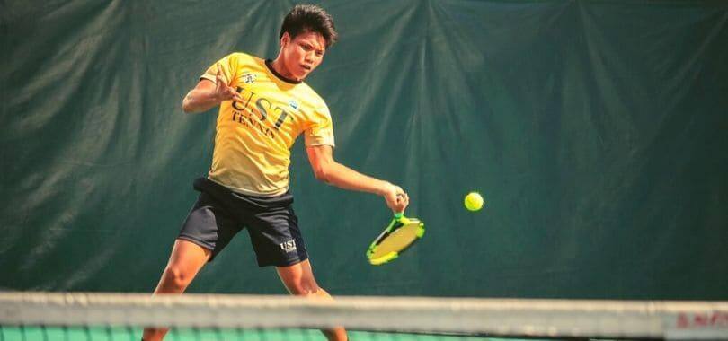A person in yellow playing tennis.