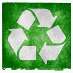 Recycle triangle symbol on a green background.
