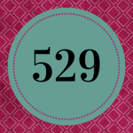 A purple background with a dark green circle, with the number 529 in the center.