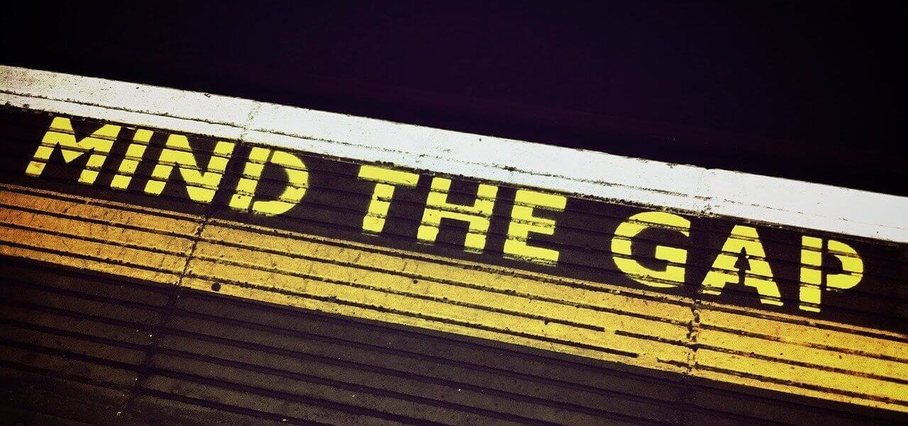 """Mind the Gap"" printed on the ground."