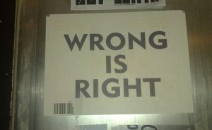 """Wrong is Right"" written on a paper."