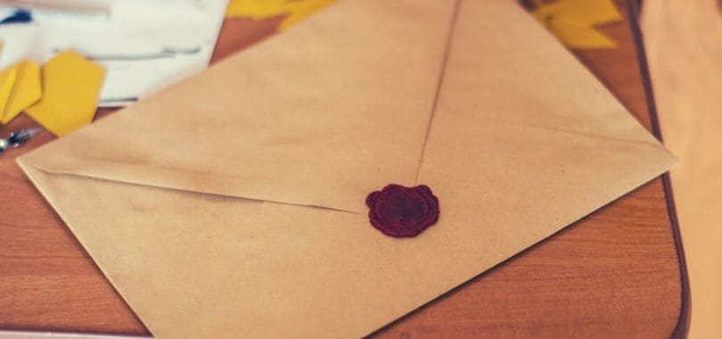 A brown letter with a red wax seal.