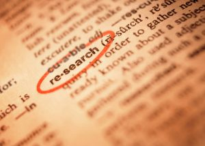 """A word """"researched"""" is encircled in a textbook."""