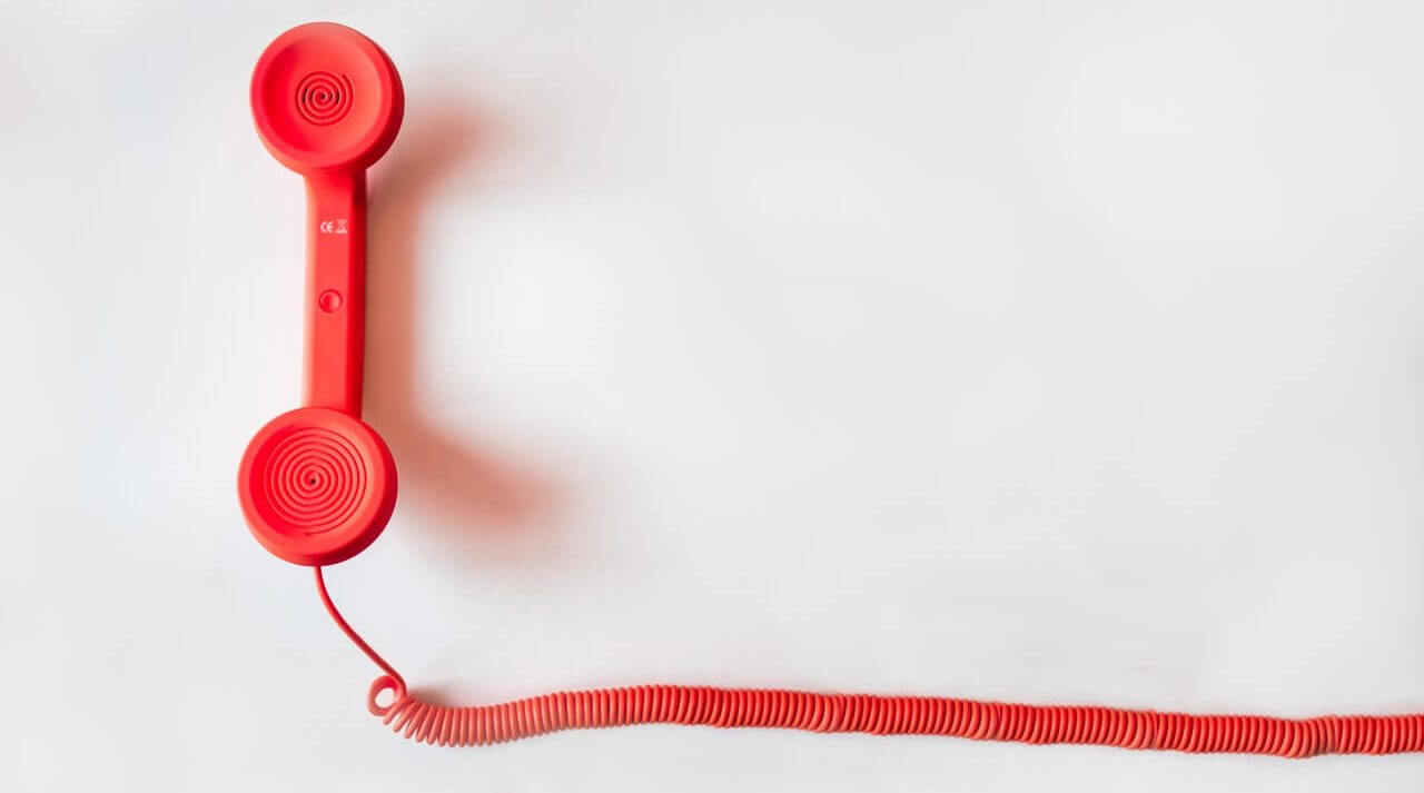 Red phone handle with a cord.
