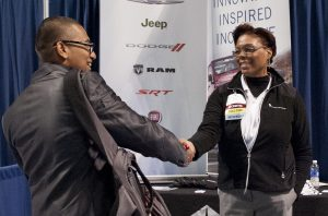 Man and woman shaking hands during Penn State Fall Career Days Fair.