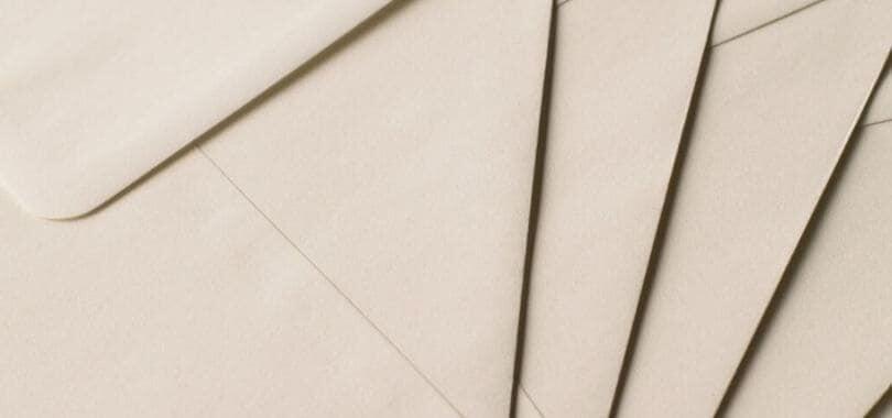 Beige envelopes stacked together.
