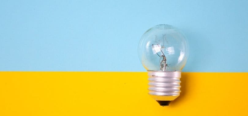 A light bulb against a blue and yellow background.