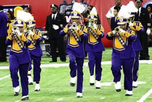 Alcorn State University marching band playing trumpets.