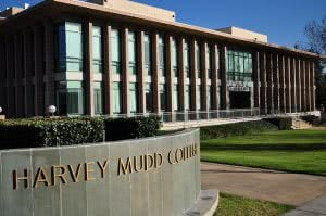 Harvey Mudd campus building with a sign that has the college's name on it.