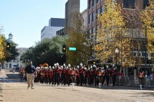 Jackson State University marching band parading on the street.