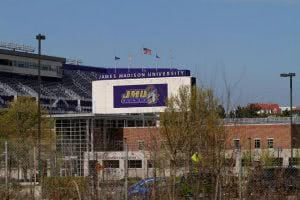 James Madison University stadium with a purple sign.