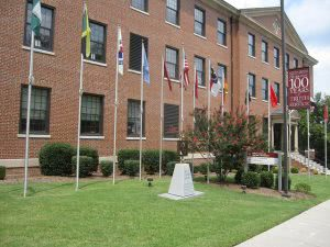 A North Carolina Central University building and flag poles in front.