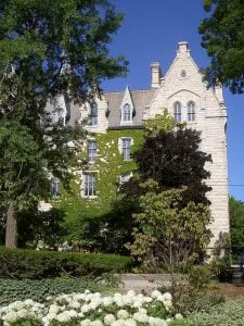 A building at Northwestern University covered trees.