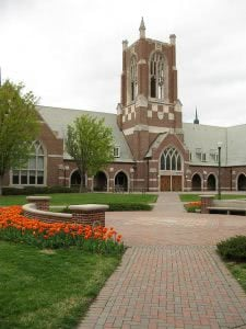 Jepson Hall in University of Richmond campus with orange flowers on the foreground.