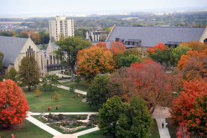 St. Olaf College Campus surrounded by autumn trees.