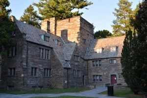 Swarthmore College campus building surrounded by trees.