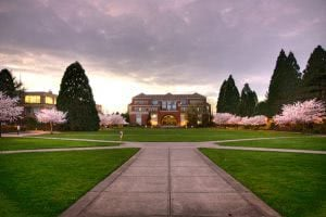 University of Portland academic quad in spring with blooming trees.