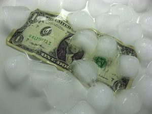 A dollar bill under melting ice cubes.