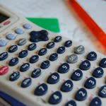 White calculator over a paper.