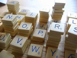 Letter tiles in scrabble game piled up.
